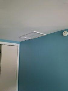 attic hatch door in a ceiling